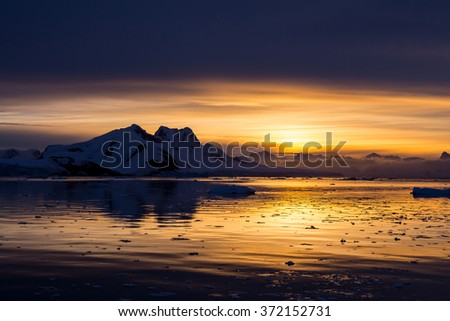 Sunset in the middle of Lemaire Channel, Antarctica