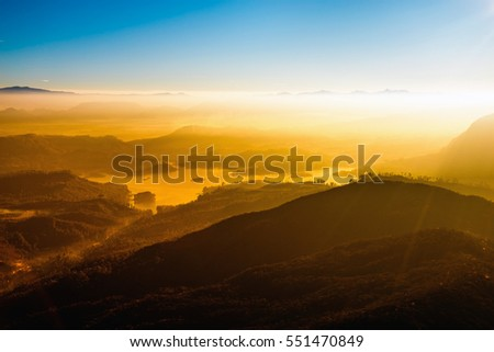 Sunset in the mountain landscape. Young freedom on mountain peak.