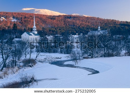 Sunset in the mountains behind the community church in the village of Stowe Vermont, USA. - stock photo