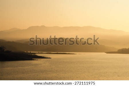 sunset in the mountains , sunrise on river - stock photo
