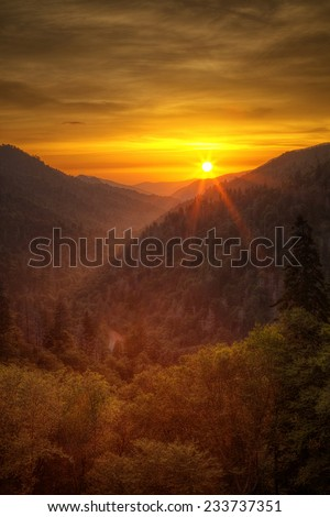 Sunset in the Mountains - The sun sets over the Morton Overlook in the Great Smoky Mountains National Park. - stock photo