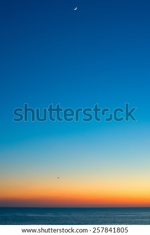 Sunset in the ocean. Minimalism. Cascais, Portugal - stock photo