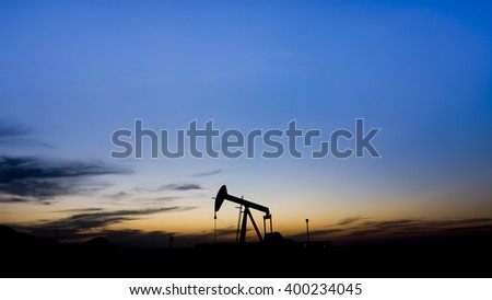 Sunset in the oil field - Silhouette of crude oil pump - Bahrain