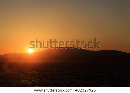 Sunset in the open sea with lense flares