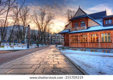 Sunset in the park of Zakopane at winter time, Poland - stock photo