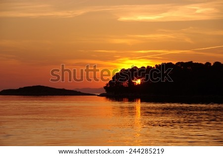 Sunset in the Pomena bay of the island Mljet in the Adriatic sea of Croatia - stock photo