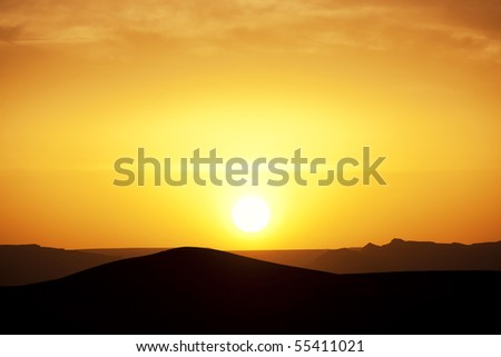 Sunset in the Sahara desert. Concept of holiday and traveling. - stock photo