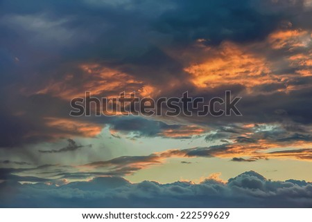Sunset in the sky with storm clouds - stock photo