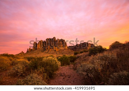 sunset in the superstition mountains - stock photo