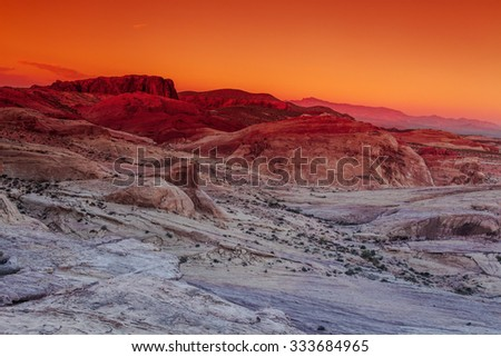 Sunset in the Valley of Fire State Park, USA. Valley of Fire State Park is the oldest state park in Nevada, USA and was designated as a National Natural Landmark in 1968. - stock photo