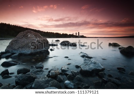Sunset in the western part of Sweden - stock photo