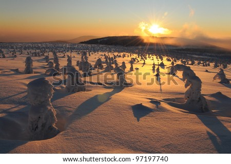 Sunset in the winter mountains, The Krkonose mountain, Czech republic - stock photo