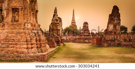 Sunset in Wat Mahathat. Ayutthaya historical park. Panorama - stock photo