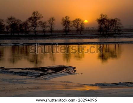 Sunset in winter,a pieceful view - stock photo