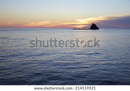 sunset & island - stock photo