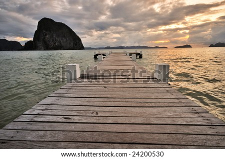 Sunset Jetty into the sea - stock photo