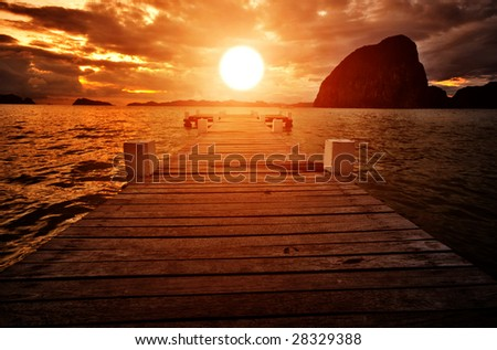 Sunset Jetty into the Sunset - stock photo