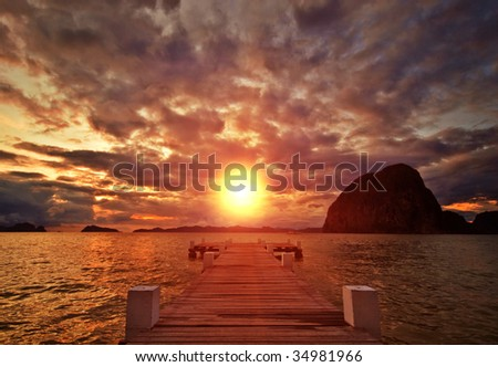 Sunset Jetty on Paradise Island - stock photo