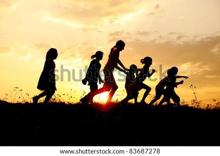 Sunset kids running - stock photo