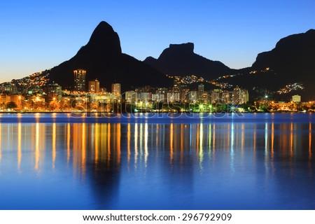 Sunset Lagoon Rodrigo de Freitas (Lagoa), mountain Two brothers, Stone of Gavea, Rio de Janeiro, Brazil - stock photo