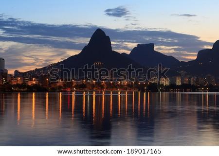 Sunset Lagoon Rodrigo de Freitas (Lagoa), mountain Vidigal, Stone of Gavea, Rio de Janeiro, Brazil - stock photo