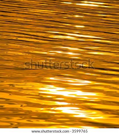 Sunset lake as liquid gold - stock photo