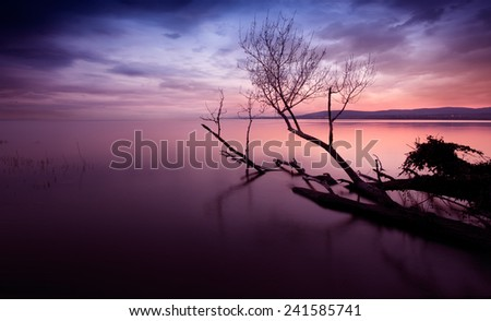 Sunset lake with  dark clouds. This photo make in Hungary.   - stock photo