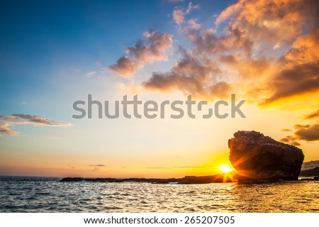 Sunset.  Lanai, Hawaii. Sweetheart rock.  Puu Pehe.  - stock photo