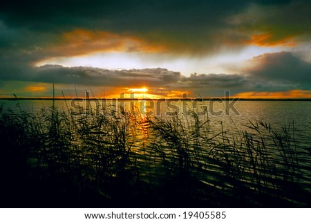 Sunset landscape at the lake in Siberia - stock photo