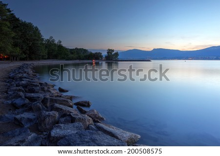 Sunset landscape of the Lake Neuchatel in Switzerland, by the beach of Yvonand. - stock photo