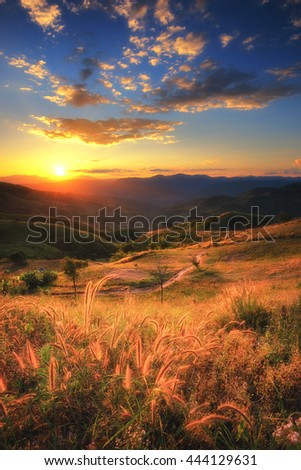 Sunset landscape view of mountain and beautiful sky at Doi Chang, Chiangrai province, Thailand.