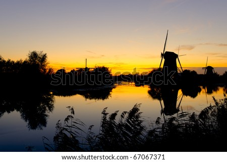 Sunset landscape with silhouetted windmills at Kinderdijk, The Netherlands - stock photo