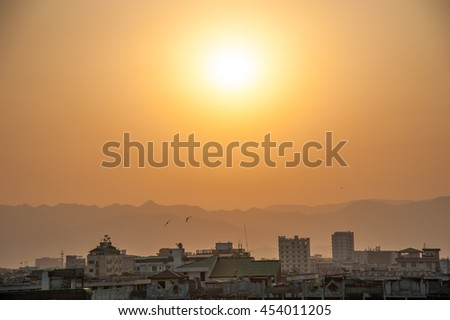 Sunset light with foggy , building and mountains at Mandalay, Myanmar - stock photo