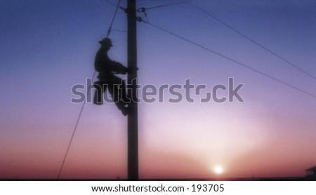 Sunset lineman - stock photo