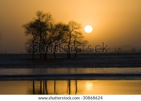 sunset  making a peaceful view - stock photo