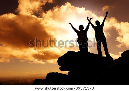 sunset mountain climbing victory celebration - stock photo