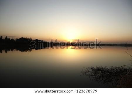 sunset near a lake - stock photo