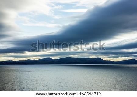 Sunset - Norwegian summer seascape - stock photo