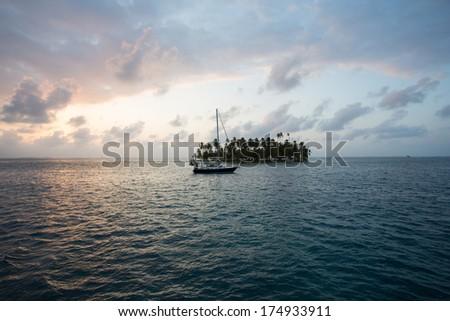 Sunset, ocean and coconut trees near paradisiac island in San Blas Islands, Panama 2014. - stock photo