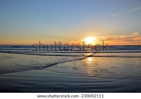 Sunset ocean  cool water  beautiful sun in the sky. - stock photo