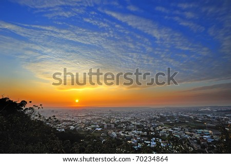 Sunset of my hometown , view from mountain. - stock photo