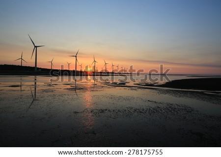 sunset of wind farm - stock photo