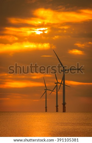 Sunset Offshore Wind Turbine in a Wind farm under construction off the England coast
