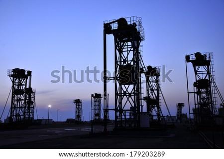 Sunset oil pump  - stock photo