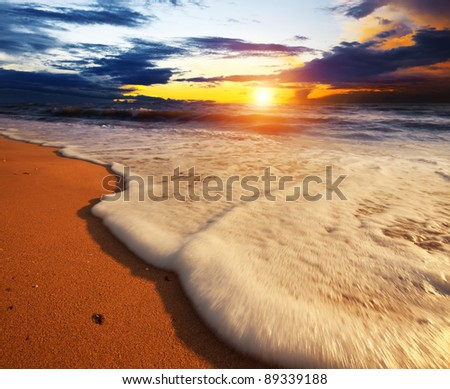 sunset on a background a sea - stock photo
