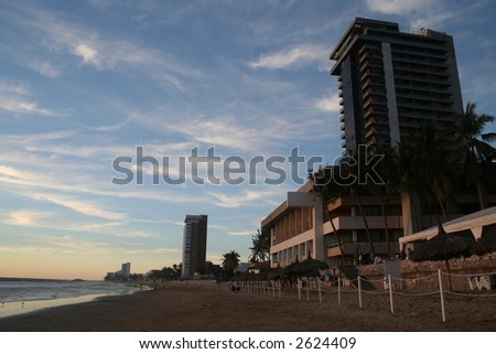 Sunset on a beach in Mazatlan - stock photo