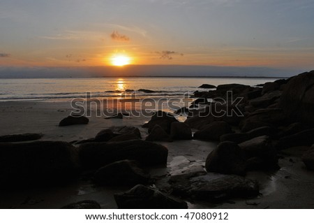 sunset on a beach of Ilha do Mel, Brasil - stock photo