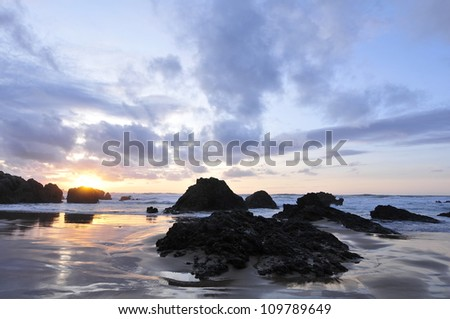 Sunset on a beach on the creek in Liencres (Santander) Cantabria - Spain - stock photo