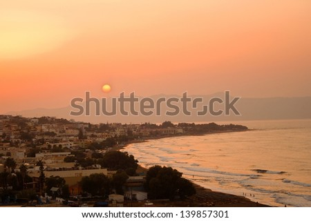 Sunset on a beautiful beach in Greece - stock photo