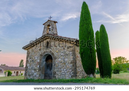 Sunset on a chapel in Villecroze in Provence, France - stock photo